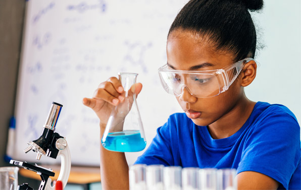student with chemistry beaker